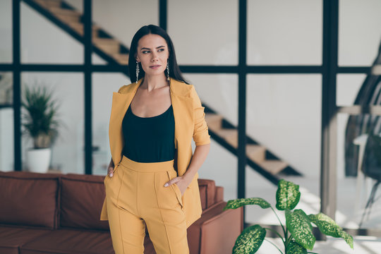 Gorgeous charming entrepreneur executive manager girl put hand pocket feel minded look good dream about her fancy beauty job wear trendy outfit in house indoors
