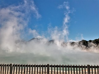 The Champagne Pools in Rotorua spew out hot smoke. This is a popular tourist destination