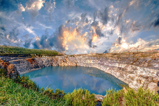 Fantastic view of Open Pit Mining on cloudy sky