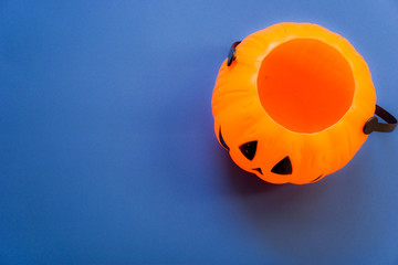 decorated pumpkin on blue background