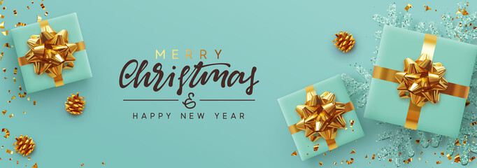 Christmas banner. Background Xmas design of realistic gifts box, blue snowflake and glitter gold confetti. Horizontal poster, greeting card, headers, website. Decoration objects flat lay, top view
