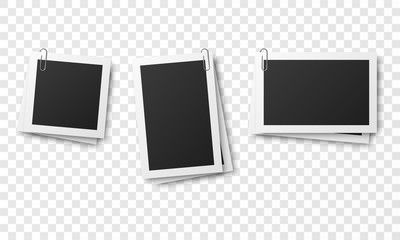 Set of vintage photo frames attached with paper clips isolated on transparent background.