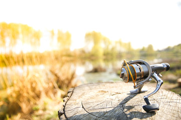background of fishing reel on the stump with copy space.