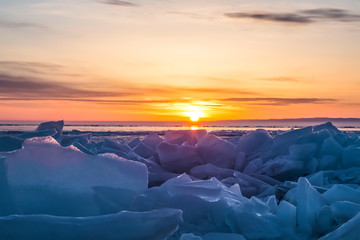 Sunrise over the ice of lake Baikal in winter, Eastern Siberia, Russia