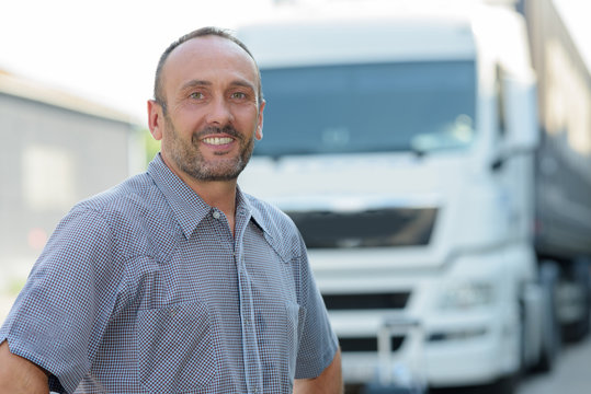 close up of a lorry truck driver smiling