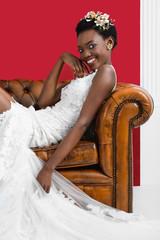 Woman trying on wedding dress of fashion des