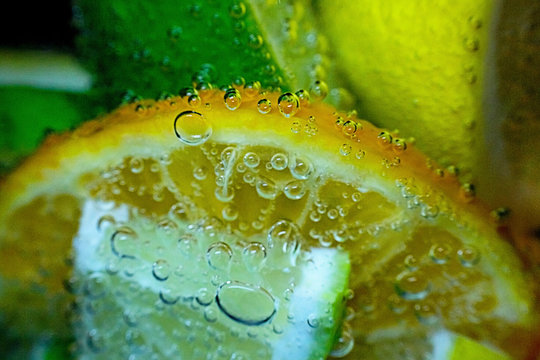 Slices of lemon, lime and orange in carbonated water