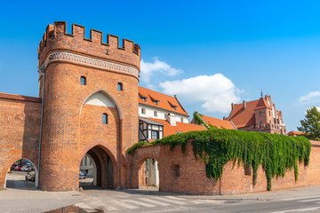 Bridge Gate (Polish: Brama Mostowa) from 1432 and city wall in Torun, Poland.