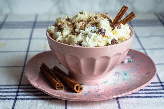 traditional rice pudding with cinnamon, milk and raisins