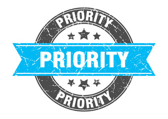 priority round stamp with turquoise ribbon. priority