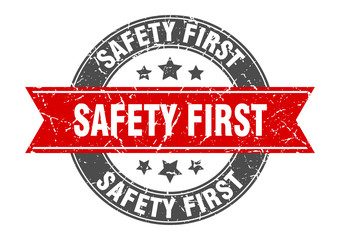 safety first round stamp with red ribbon. safety first