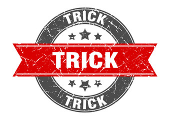 trick round stamp with red ribbon. trick