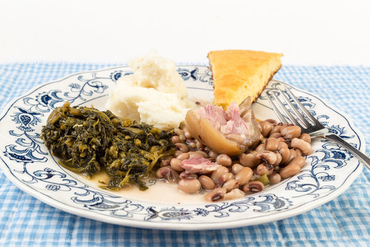 Pickled Pig Foot on Soul Food Plate with Collard Greens and Black Eyed Peas and Mashed Potatoes and Cornbread