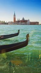 Gondolas moored at sunset, St. Mark's basin, Venice, Italy