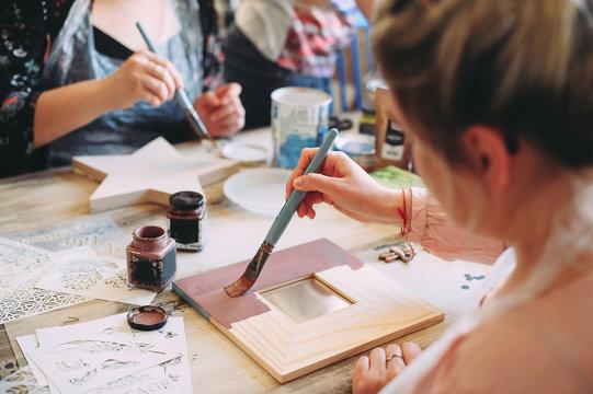 master class on creativity. girl makes a frame