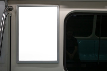 Blank advertising sign inside subway train. Close to the glass edge of the train.