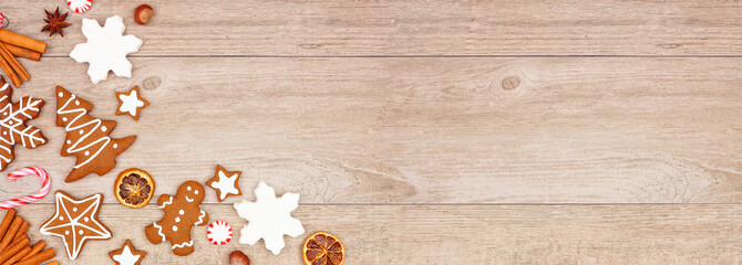 Wall Mural - Christmas gingerbread cookies, candy and baking items. Top view corner border banner on a wood background.