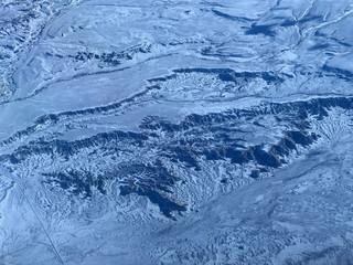 Flight Over A Snow Covered Desert Landscape
