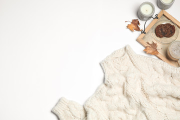 Flat lay composition with soft knitted sweater on white background