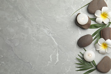 Flat lay composition with stones on grey marble background, space for text. Zen concept