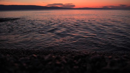 Wall Mural - Scenic Sunset at the Beach Somewhere in Northern Croatia. Calm and Warm Adriatic Sea. Vacation Destination.