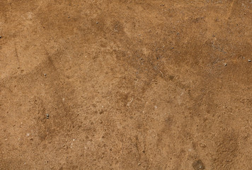 The surface of a dirty sandy floor, ground background