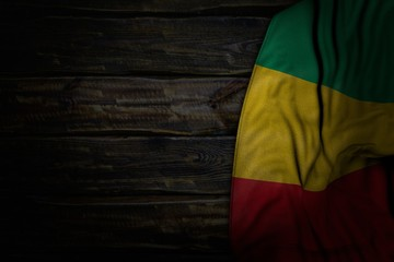 beautiful memorial day flag 3d illustration. - dark picture of Guinea flag with big folds on old wood with empty place for content