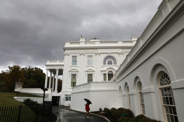Storm clouds gather over the White House