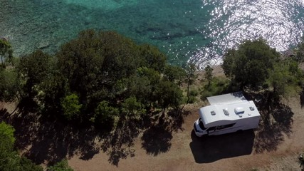 Wall Mural - Aerial Footage of Scenic Sea Front RV Campsite. Modern Motorhome Camper Van on the Mediterranean Sea Croatian Coast. Vacation on the Road. Turquoise Bay.