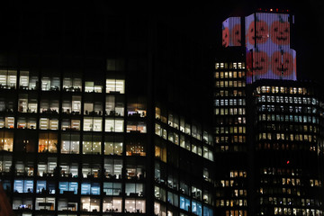 A screen showing halloween pumpkins is seen in the City of London