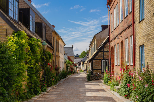 A cosy cobblestone street with half-timbered houses in the old parts of the medieval university city of Lund, Sweden.