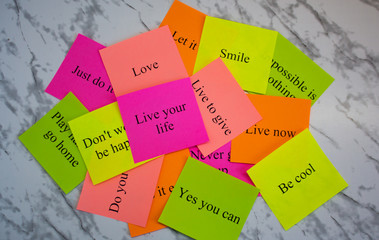 Motivational words on colorful stickers on a marble table. Business plan, strategy, concept, future. Copy space, creativity, project, art. Vision board.