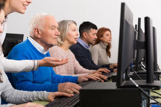 Focused senior man during computer classes