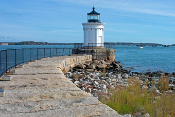 Small, white, steel lighthouse whose seams are disguised as corinthian columns, viewed from Bug Light Park in Cape Elizabeth, Maine -03