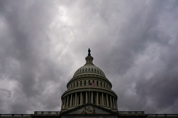 Clouds pass over the U.S. Capitol after a House vote approving rules for an impeachment inquiry into U.S. President Trump in Washington