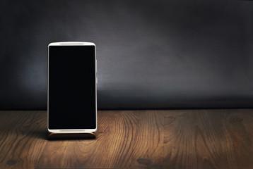 Top view, smartphone mockup on vintage wooden desk