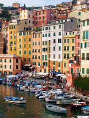 Camogli - rainbow-colored houses in the tourist resort on the west side of Portofino, on the Golf of Paradiso in the Riviera di Levante, in the Metropolitan City of Genoa, Liguria, northern Italy.