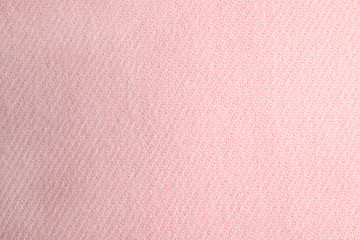 Fototapete - Pink knitted sweater as background, closeup view