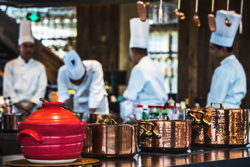 Traditional preparing food and professional Chinese cooks at kitchen.