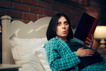 Pregnant Woman Reading a Book in Bed