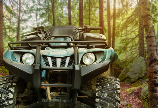 Atv vehicle standing in forest close-up front view.
