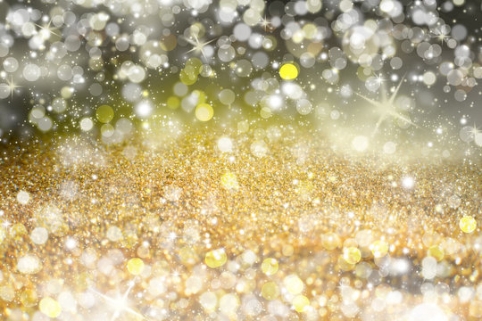 Yellow Sparkling Lights Festive background with texture. Abstract Christmas twinkled bright bokeh defocused and Falling stars