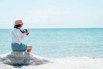 The tourist shooting in the sea on a beautiful day.
