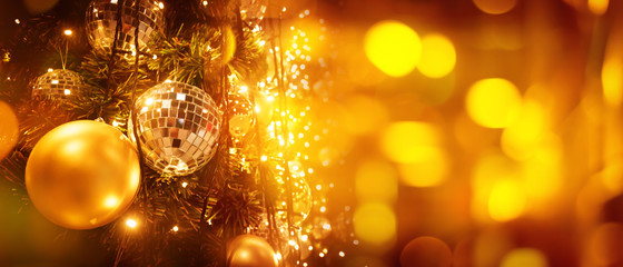 Christmas tree and blur bokeh lights background. Xmas and happy new year. Use for greeting card, cover, banner, header template.