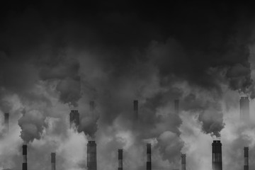 Air pollution smoke from factory chimneys dark scary sky with space for text