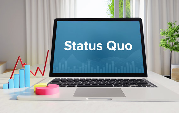 Status Quo – Statistics/Business. Laptop in the office with term on the display. Finance/Economics.
