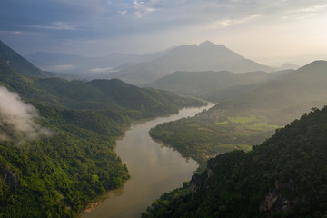 Aerial view of mountains and river Nong Khiaw. North Laos. Southeast Asia. Photo made by drone from above. Bird eye view.
