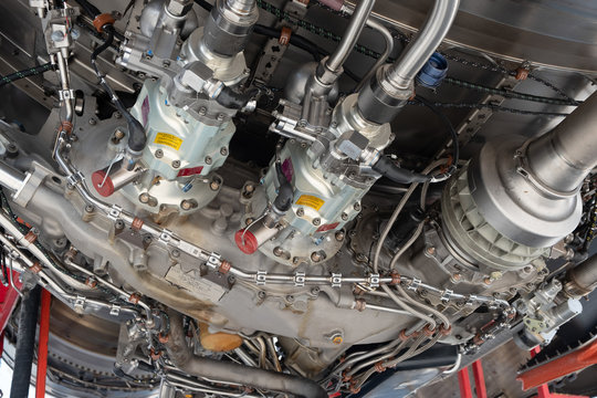 Gas turbine engine close up during maintenance when airplane park at the airport.Mechanic and technician repair hydraulic and check system of power plant.