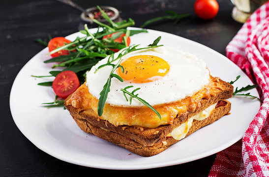 Breakfast. French cuisine. Croque madame sandwich close up on the table.