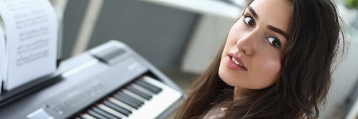 Portrait of lovely woman looking at camera with calmness and tenderness. Beautiful female recording...